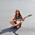 Woman Holding A Guitar Royalty Free Stock Image - 44977666