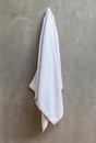 The White Towel Is Hanging On A Hanger With Concrete Wall In The Stock Images - 44980794