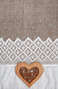 Burlap Background With Lacy Cloth And Wooden Heart Royalty Free Stock Photography - 44985087