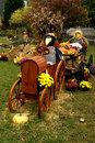 Scarecrow Driving Tractor Fall Decorations Stock Images - 44988394