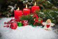 Red Candles Burning  In Snow For Third Advent Royalty Free Stock Photography - 45000257