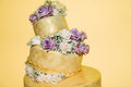 Golden Wedding Cake With Real Roses Stock Photography - 45026482