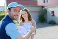 Delivery Man Handing Over A Registered Letter Royalty Free Stock Image - 45036666