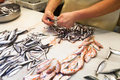 Fishmonger Preparing Fish For Selling At Fish Market Stock Photography - 45056692
