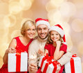 Happy Family In Santa Helper Hats With Gift Boxes Stock Photos - 45060413