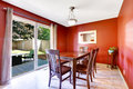 Dining Area With Bright Red Walls And Walkout Patio Stock Photos - 45068373