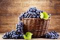 Grape In Wooden Basket Royalty Free Stock Photography - 45091157