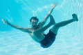 Young Man Swimming Underwater Stock Images - 45092204