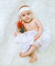 Little Cute Baby Girl Lying On A Bed Stock Photo - 45092690