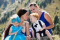 Two Happy Moms And Children Girl And Boy Hugging On Nature Stock Image - 45133171
