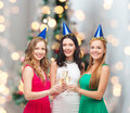 Smiling Women Holding Glasses Of Sparkling Wine Royalty Free Stock Images - 45139989