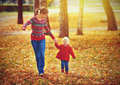 Happy Family Mother And Child Little Daughter On Autumn Walk Royalty Free Stock Images - 45149769