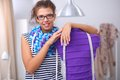Smiling Fashion Designer Standing Near Mannequin Stock Photos - 45151903