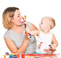 Happy Child Draws On The Face Of His Mother. Royalty Free Stock Photos - 45169508