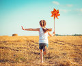 Cute Little Girl With A  Windmill Royalty Free Stock Photos - 45172418
