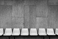Plastic Chairs On Cement Wall Stock Image - 45173931