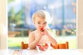 Little Girl Eating Delicious Strawberries Royalty Free Stock Images - 45193589