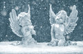 Little Guardian Angels In Snow. Christmas Decoration Stock Photos - 45197843