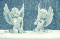 Little Guardian Angels In Snow. Christmas Decoration Royalty Free Stock Image - 45199386