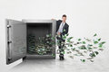 Businessman With A Large Safe Full Of Money Royalty Free Stock Photos - 45202058