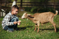 Cute Little Boy Feeding Goat Stock Photos - 45206133