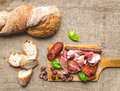 Meat Appetizers Selection And A Loaf Of Rustic Village Bread On Stock Photos - 45208183