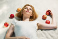 Happy Young Woman With Apples Lying On Plaid Stock Photos - 45215233