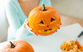 Close Up Of Woman With Pumpkins At Home Stock Photo - 45215670