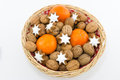 Basket With Walnuts, Tangerines And Cinnamon Stars Royalty Free Stock Photography - 45217557