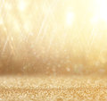 Glitter Vintage Lights Background. Abstract Gold Background . Defocused Royalty Free Stock Photo - 45266925