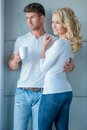 Attractive Couple Standing Looking Out Of A Window Stock Image - 45269701