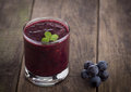 Glass Of Grape Juice Smoothie On Wooden Stock Photography - 45280432