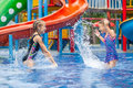 Two Little Kids Playing In The Swimming Pool Royalty Free Stock Photography - 45288217
