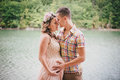 Young Pregnant Woman With Her Husband Standing Near Lake Stock Images - 45289894