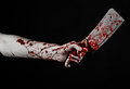 Bloody Halloween Theme: Bloody Hand Holding A Large Bloody Kitchen Knife On A Black Background Isolated Stock Image - 45298371