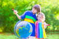 Beautiful Kids Playing With Airplanes And Globe Royalty Free Stock Images - 45309969