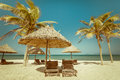 Amazing Tropical Beach With Palm Trees, Chairs And Umbrella Royalty Free Stock Image - 45338256