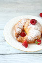 Croissant With Raspberries On A White Plate Stock Photos - 45345033
