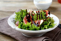 Light Salad With Figs, Lettuce And Balsamic Sauce In A White Bow Royalty Free Stock Photos - 45345948