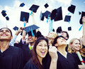 Graduation Caps Thrown In The Air Royalty Free Stock Photos - 45364748