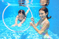 Happy Active Kids Swim In Pool And Play Underwater Royalty Free Stock Photo - 45381415