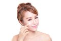 Young Woman Applying Moisturizer Cream On Face Stock Photo - 45385680