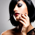 Face Of A Woman With Beautiful Dark Nails And Sexy Red Lips Royalty Free Stock Photo - 45389085