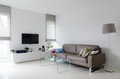 White Living Room With Taupe Sofa Stock Image - 45394171