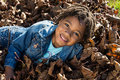 Girl In The Leaves Royalty Free Stock Photo - 45402105