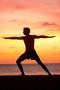 Yoga Man Training And Meditating In Warrior Pose Royalty Free Stock Images - 45402349