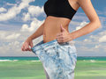 Woman With Big Jeans Weight Loss Stock Image - 45404511