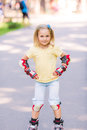 Little Girl Rollerskating In The Park Royalty Free Stock Photo - 45407005