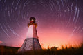 Lighthouse With Night Sky At Background Stars Trails Royalty Free Stock Photography - 45414257