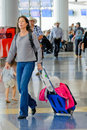 Passengers Walking With Luggage In An Airport Stock Photo - 45420970